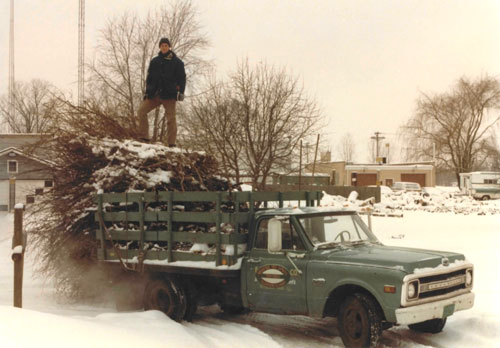 Gilbert Smith in 1982 on Arborsmith's first truck.