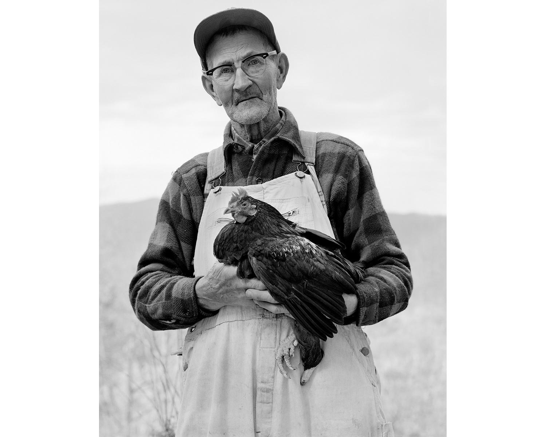 Man one legged chicken gamecock fighting Appalachian photograper Tim Barnwell