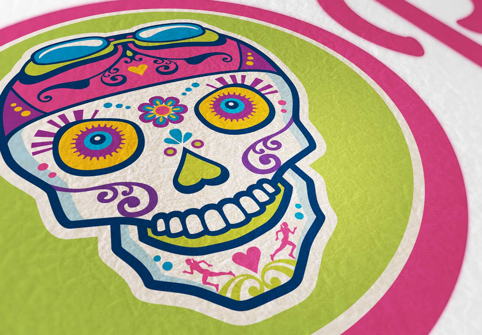 The client requested that the sugar skull feature elements of woman's multisport, swim cap and goggles, bike gears (eyes) and running (chin).