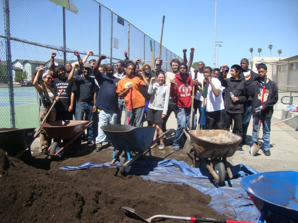 Students at McClymonds High School move over 15 cubic yards of rich organic compost into the raised beds they built on campus.