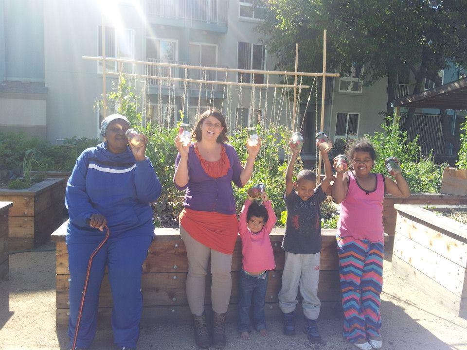 Haleh with Keller Plaza residents making vitamin water in their urban garden.