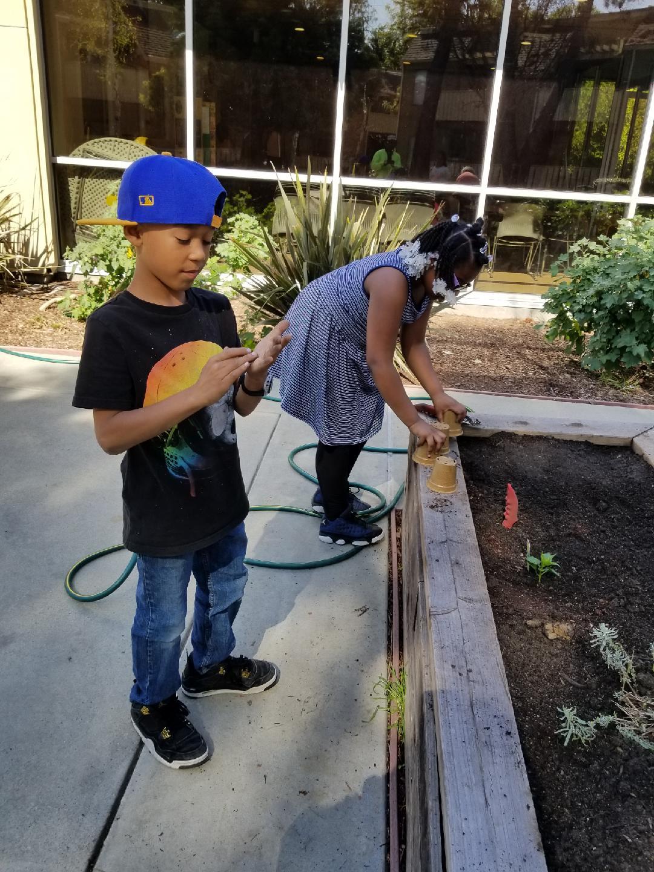 children at Community Justice Garden, Ashland Apartments