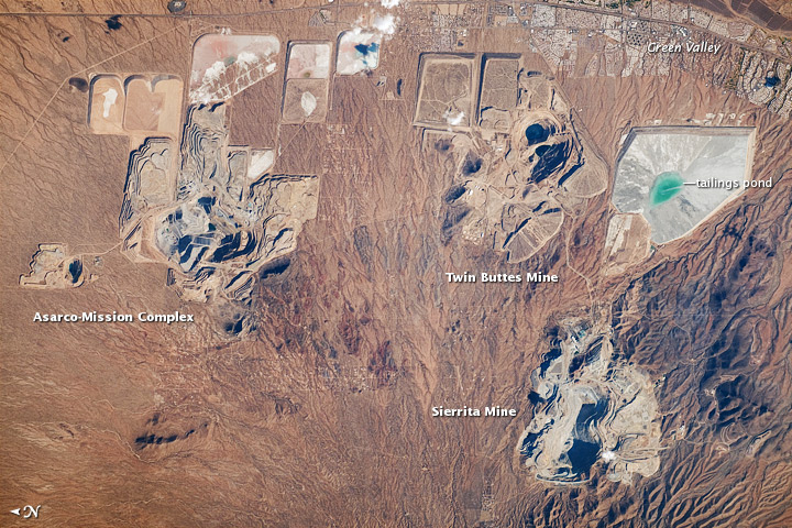 Photo: Open pit mines outside of Green Valley, Arizona (occupied territory of Hohokam people) as seen from satellite