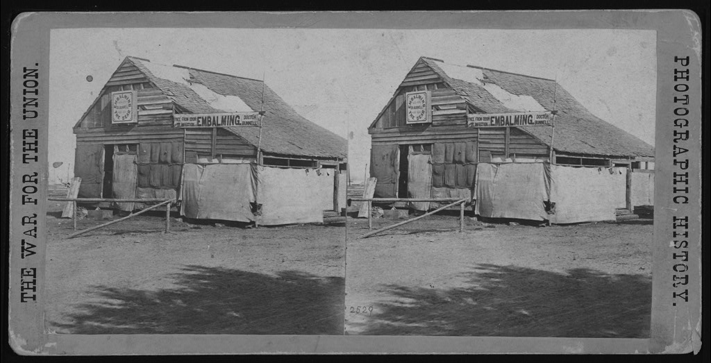 Embalming building in the field, Army of the James, before Richmond. A great many bodies of the slain are embalmed here, preparatory to sending them North for burial. [Stereograph]