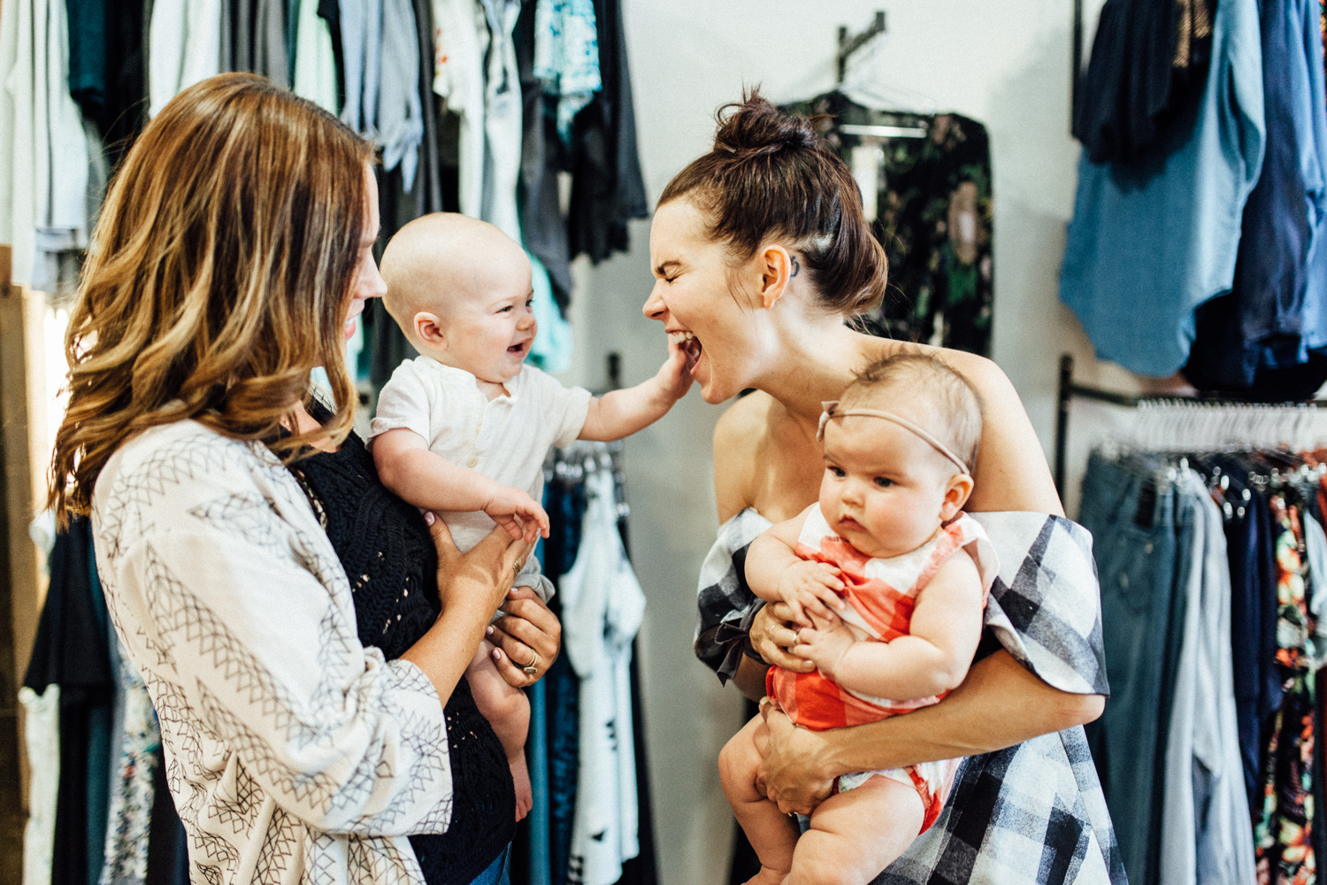 Candid-photo-of-Blaire-Isleib-and-Kristen-Doyon-working-moms-and-owners-of-Flight-Boutique
