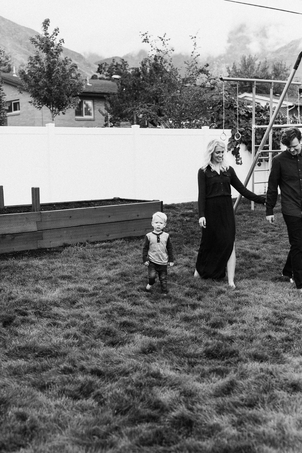 candid black and white portrait of family in millcreek utah