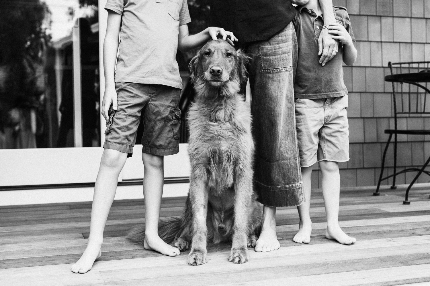 bw-photograph-of-dog-and-family-at-home-holladay-utah