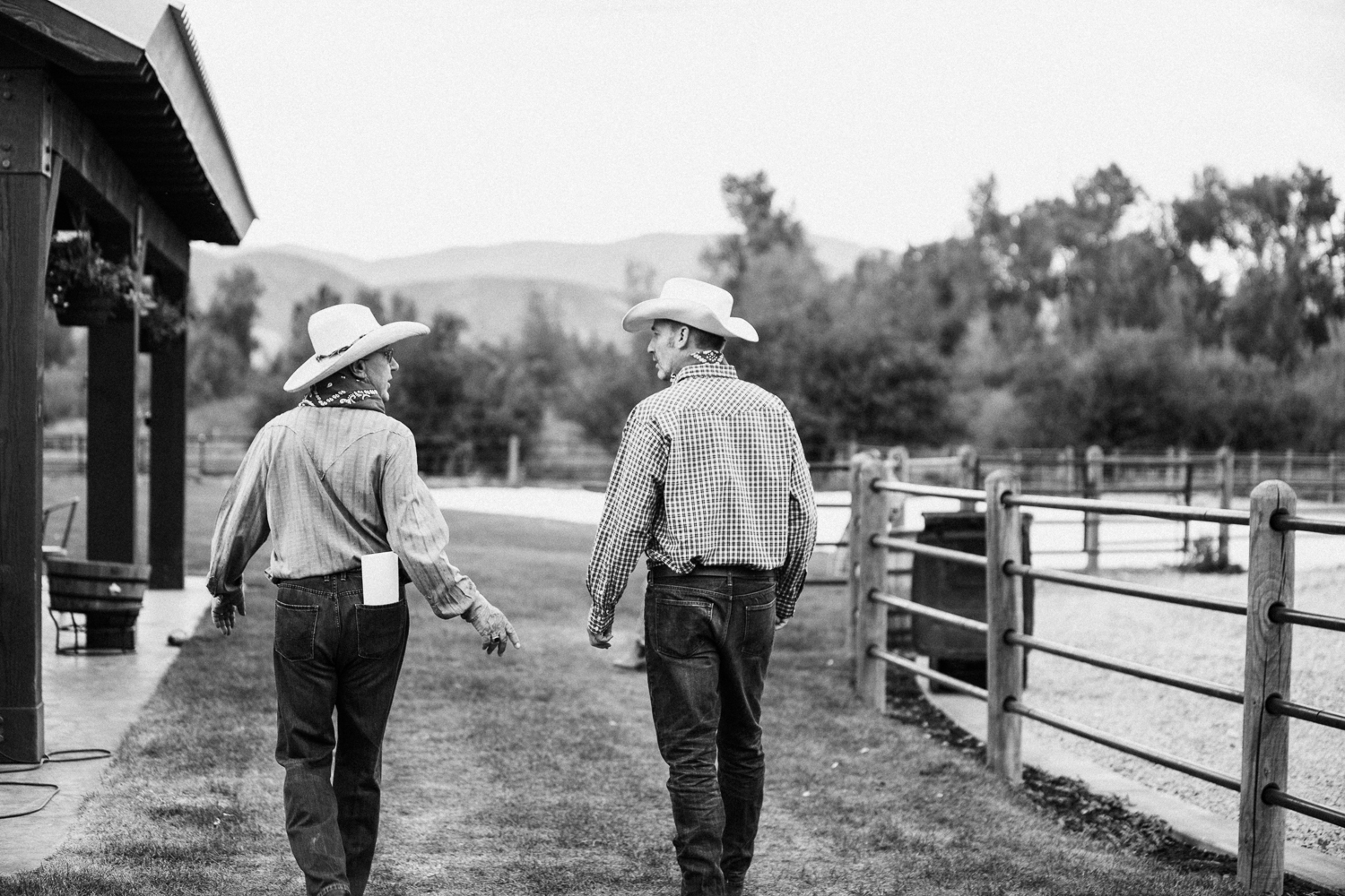 candid-black-and-white-father-son-image-heber-utah-labor-day-family-celebration-jen-fairchild-photography