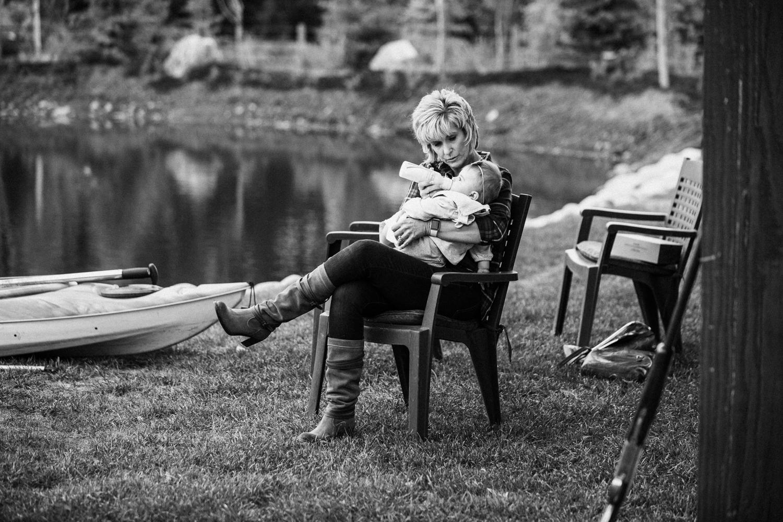 documentary-photograph-of-aunt-feeding-baby-legacy-days-heber-utah