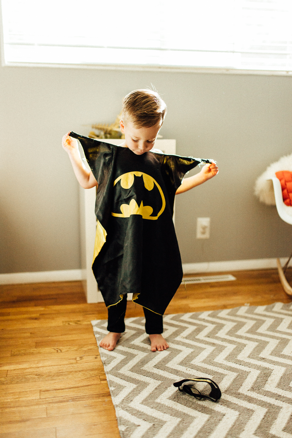 little-boy-and-batman-cape-in-home-family-photographer-salt-lake-city-utah