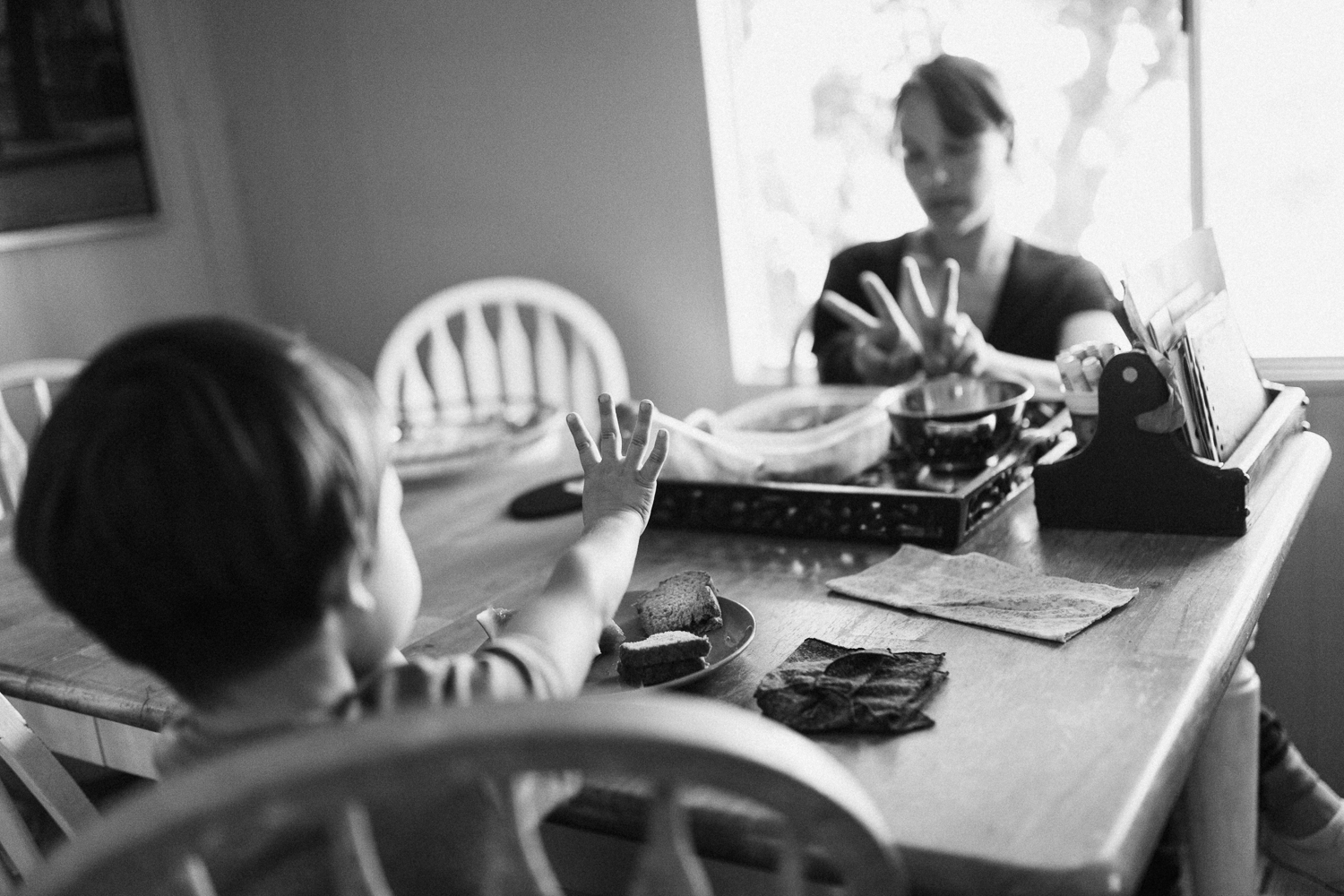 mother-and-son-addition-during-lunch-day-in-the-life-photography-session-san-diego-california