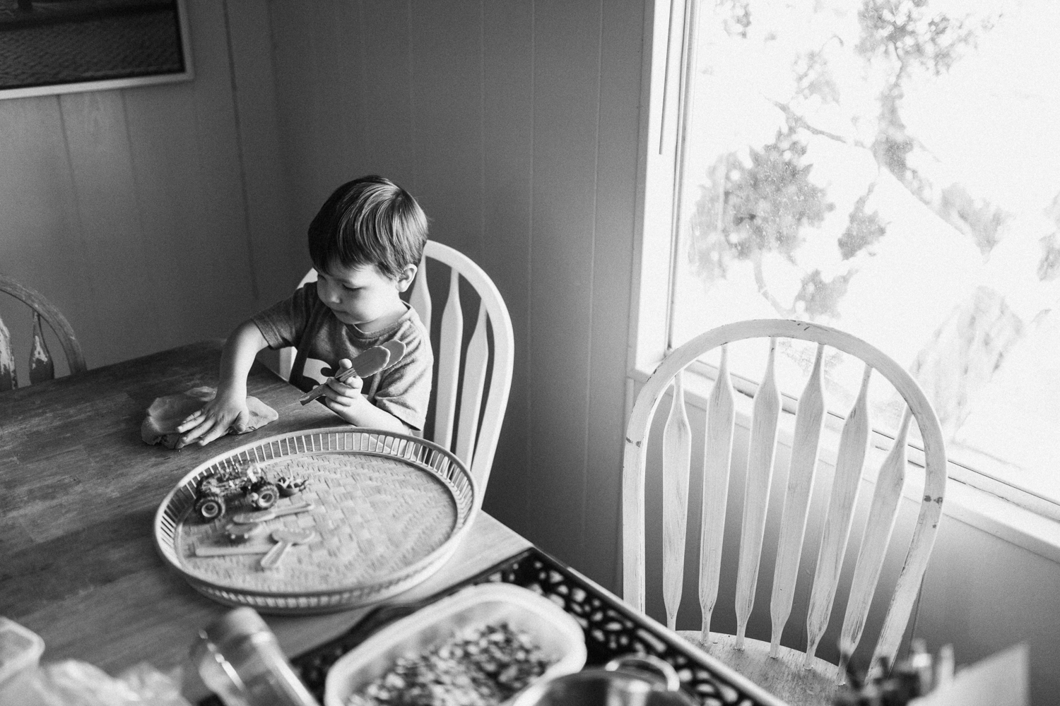 young-boy-playing-with-playdough-in-the-kitchen-lifestyle-photography-session-in-san-diego-california