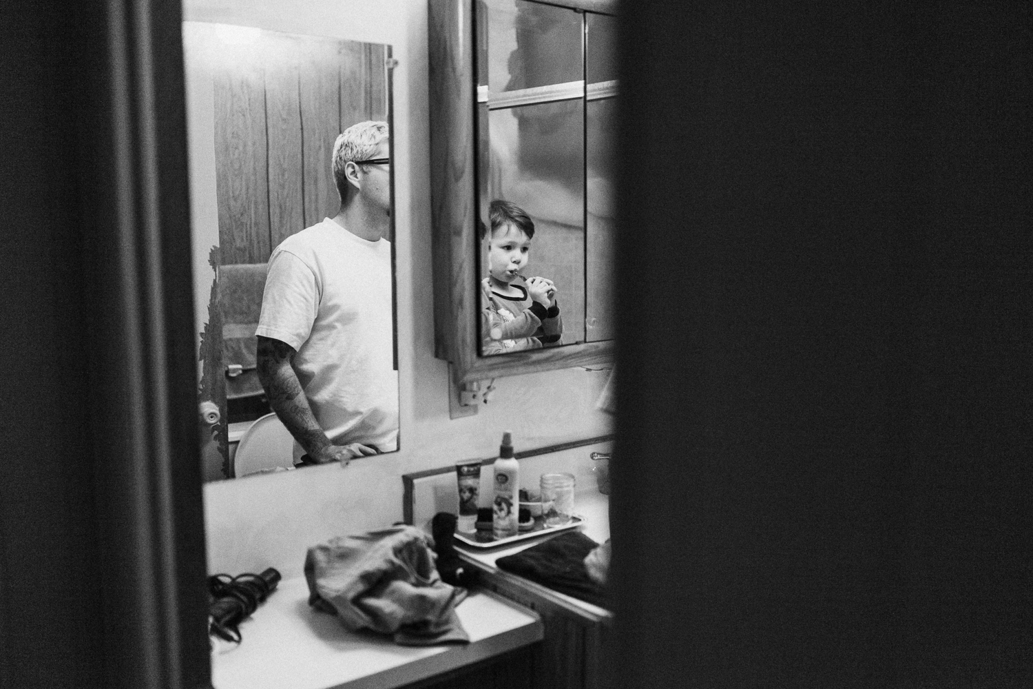 candid-photo-of-father-and-son-brushing-teeth-san-diego-california