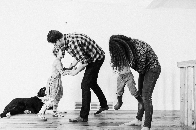 family-playing-tag-at-home-millcreek-utah