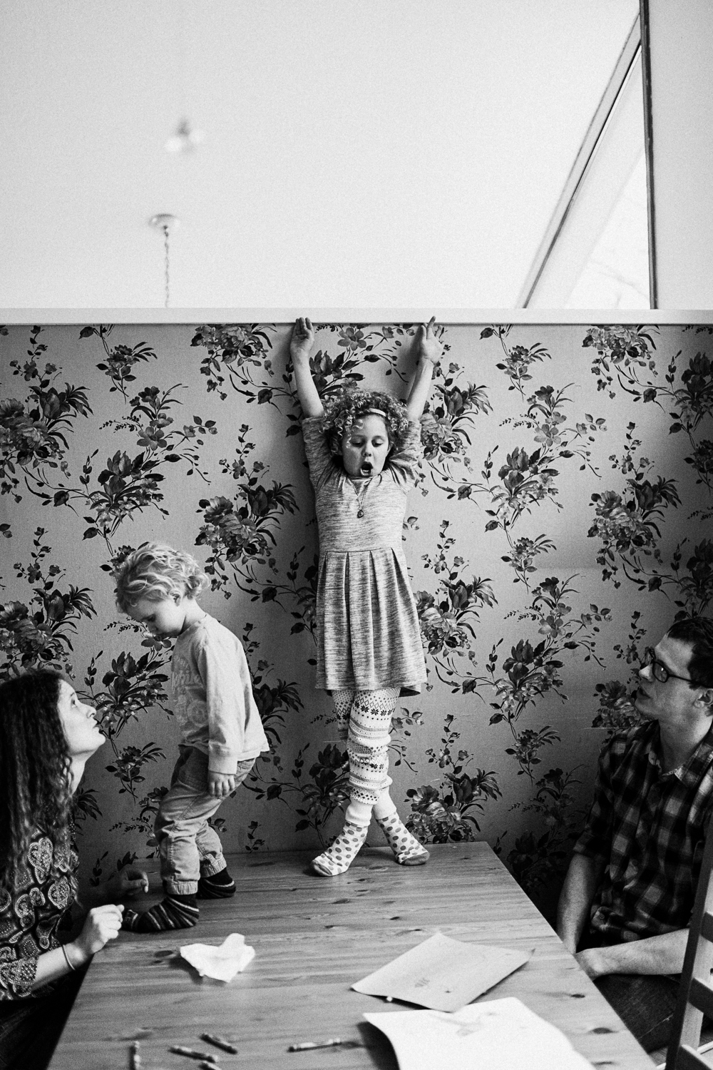 little-girl-on-table-striking-a-pose-in-home-family-documentary-photography-session-with-jen-fairchild-salt-lake-city-utah