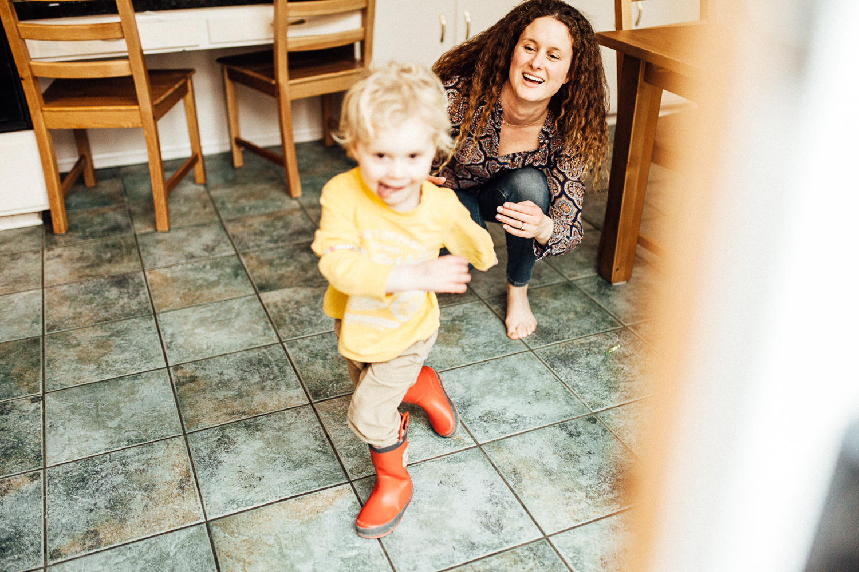 little-boy-running-to-play-outside-documentary-family-photographer-salt-lake-city-utah