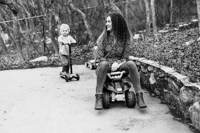 candid-shot-of-mom-on-kid-toy-in-home-lifestyle-shoot-salt-lake-city-utah