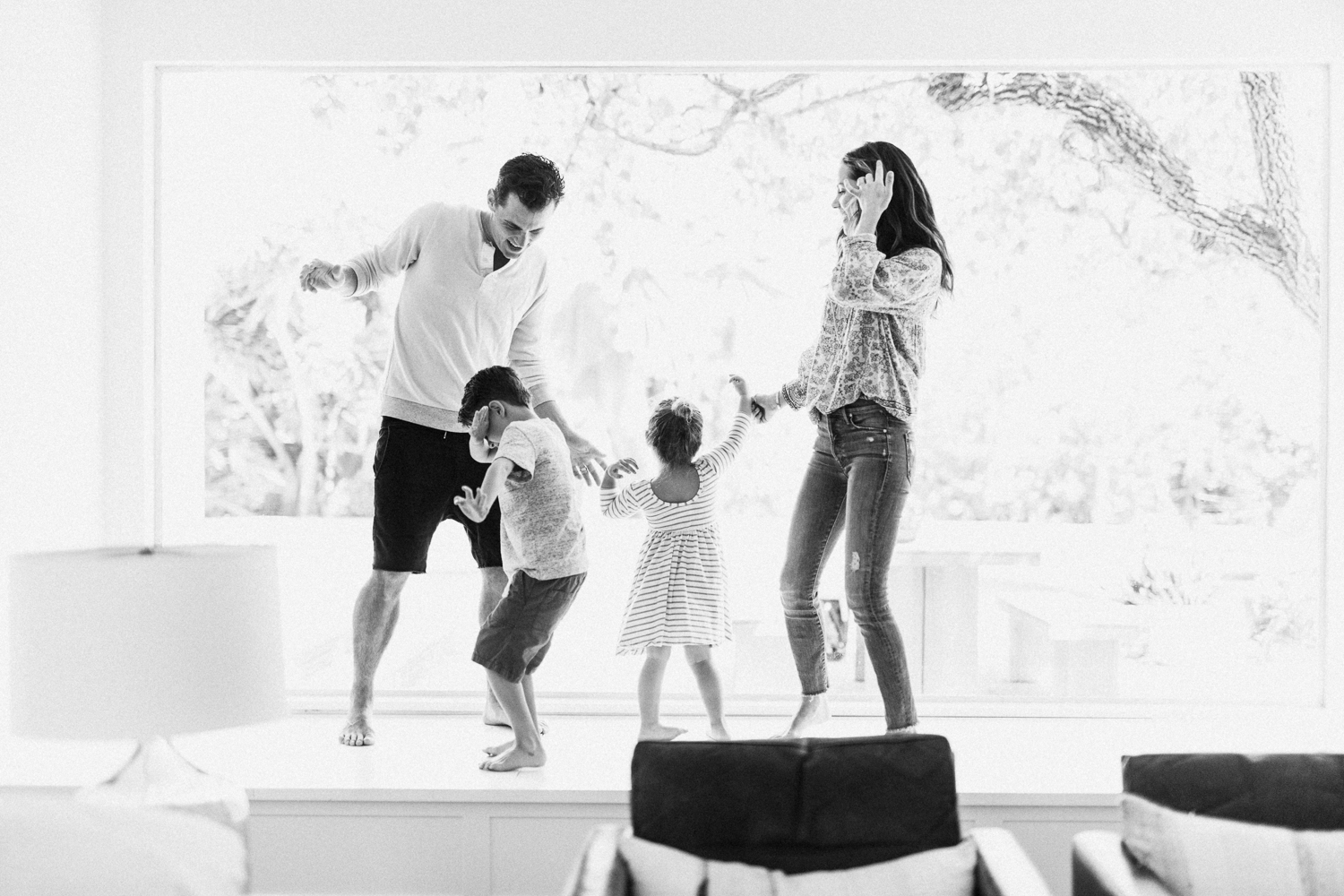 candid-photograph-of-family-dancing-at-home-documentary-family-session-newport-beach-ca