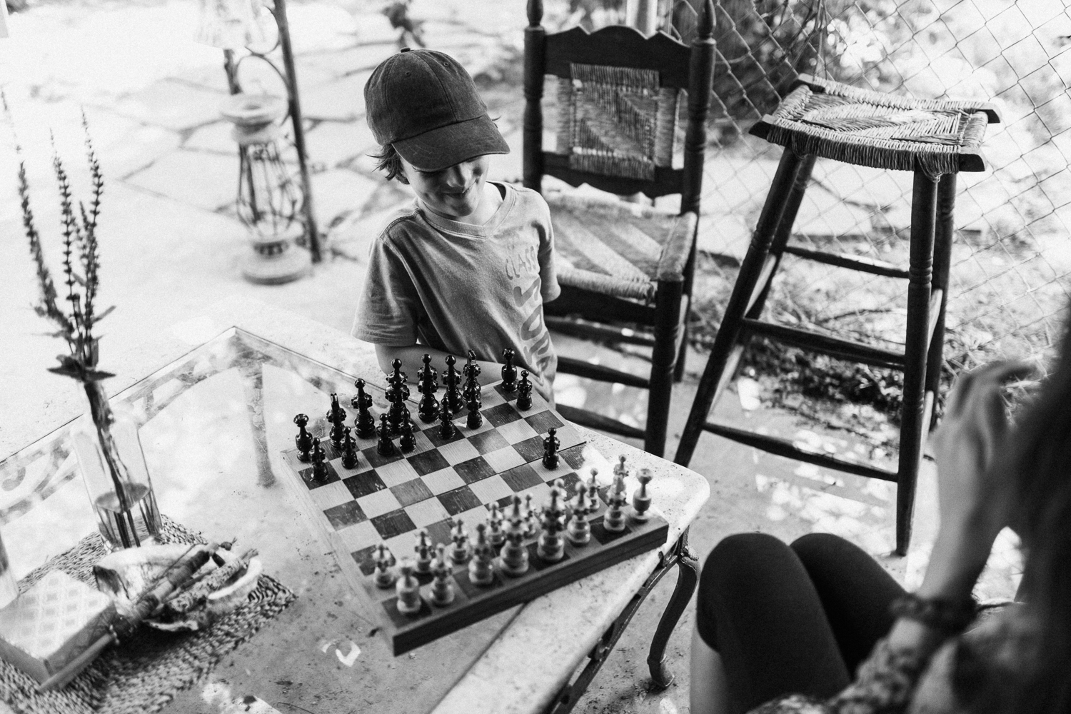 black-and-white-boy-chess-outdoors-in-home-family-session-with-jen-fairchild-photography-in-sugarhouse-saltlakecity-utah