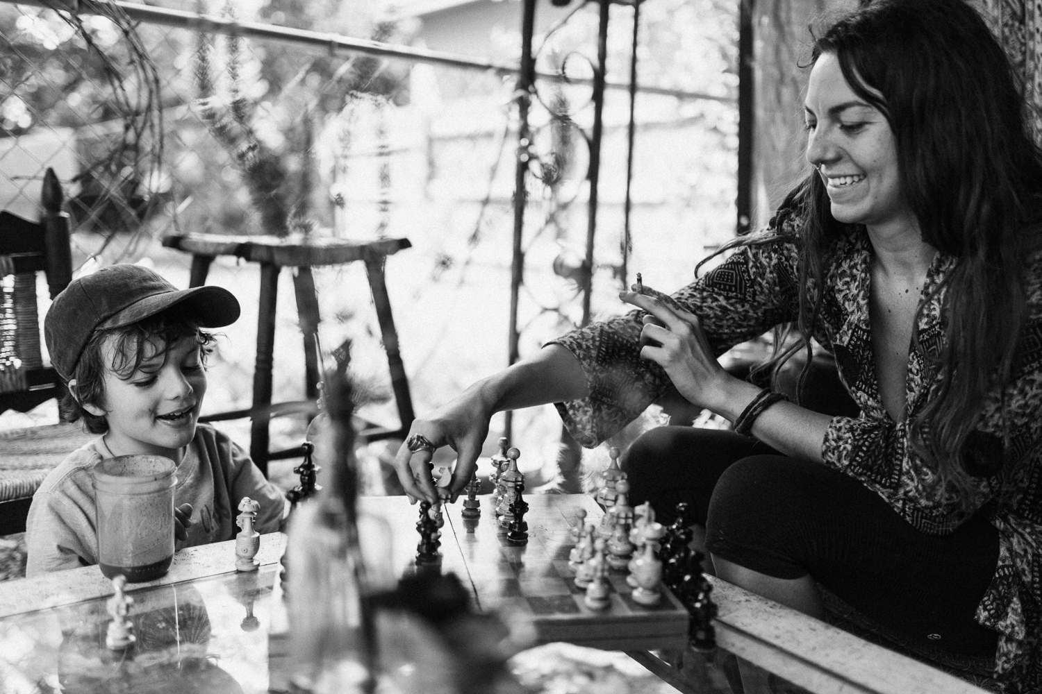 boy-and-mom-playing-chess-black-and-white-outdoor-living-sugarhouse-slc-utah