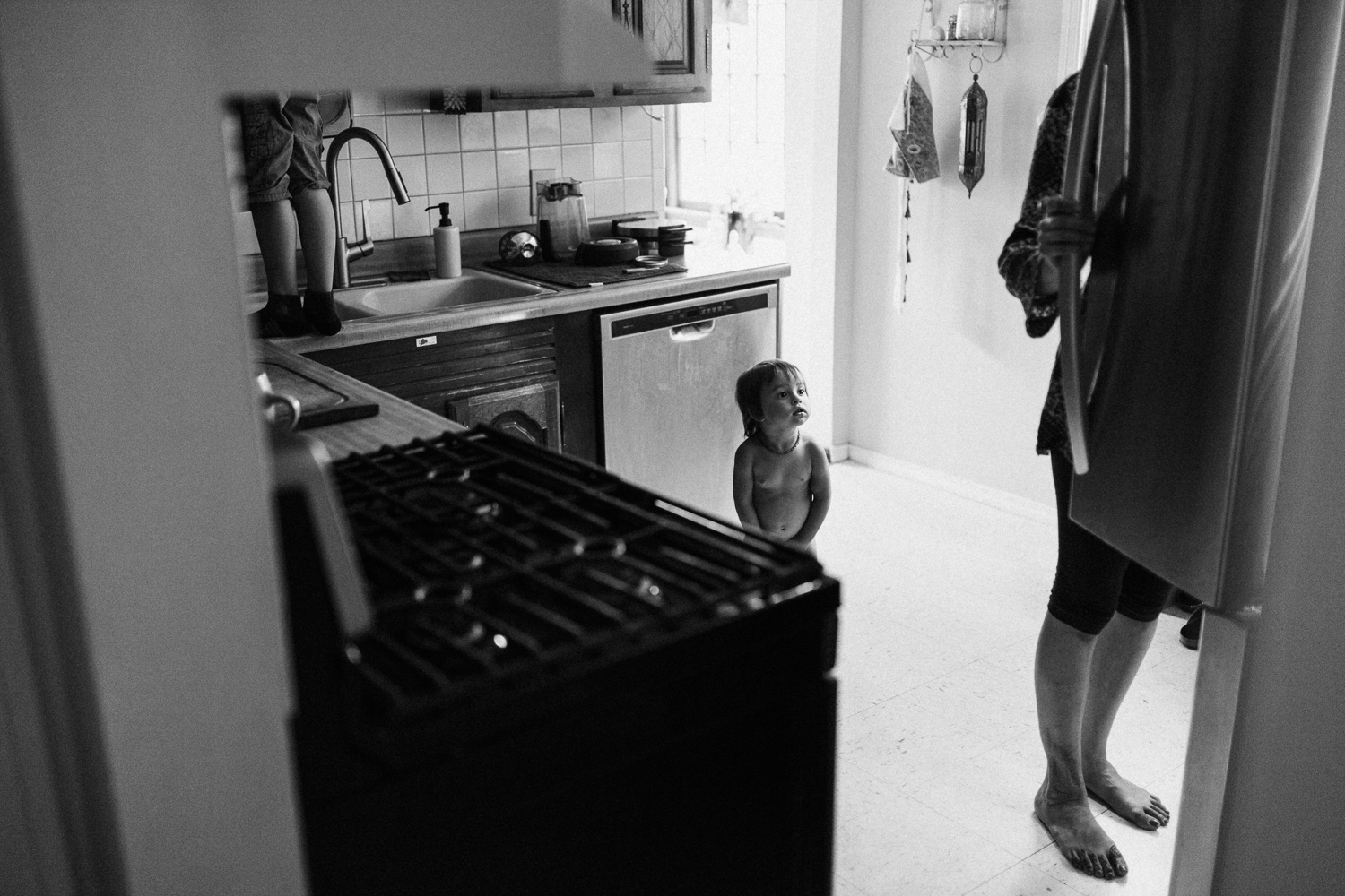 mother-and-sons-in-kitchen-getting-snacks-Nikol-family-in-home-photo-session-with-jen-fairchild-photography-saltlakecity-utah