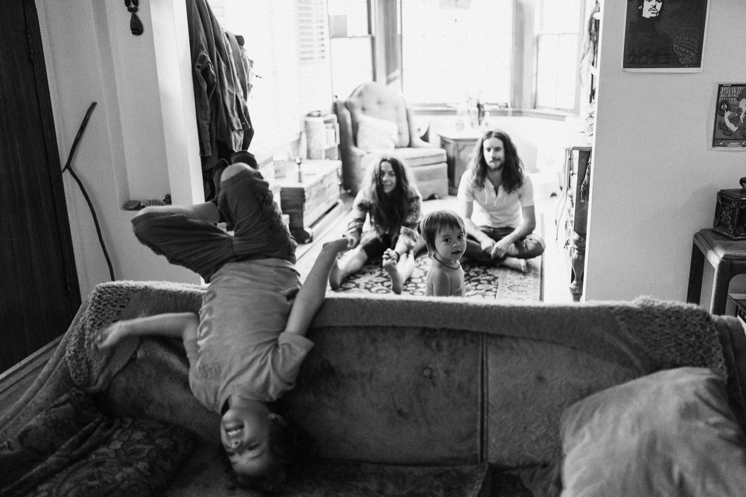 family-goofing-around-in-living-room-during-in-home-family-photo-session-with-jen-fairchild-photography-in-sugarhouse-salt-lake-city-utah