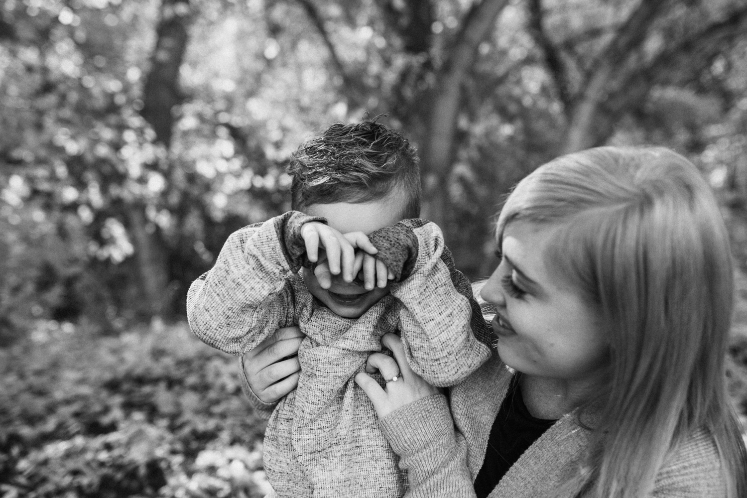 candid-black-and-white-photo-of-mother-and-son-rotary-glen-park-slc-ut