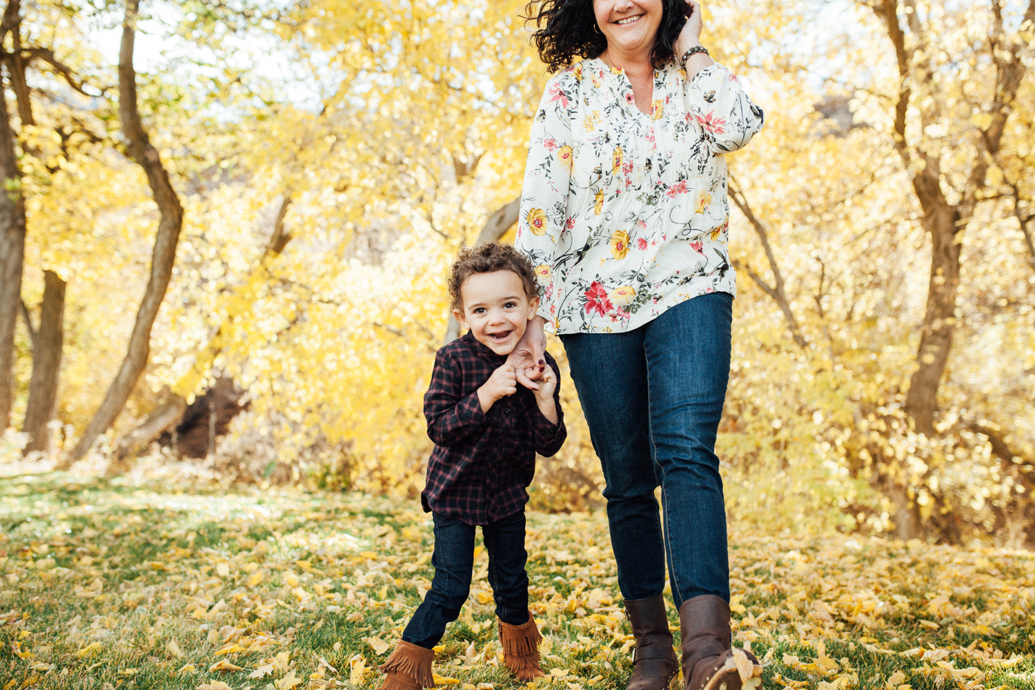 candid-photo-of-mother-and-son-in-fall-leaves-during-free-mini-shoot-with-jen-fairchild-photography-in-salt-lake-city-utah