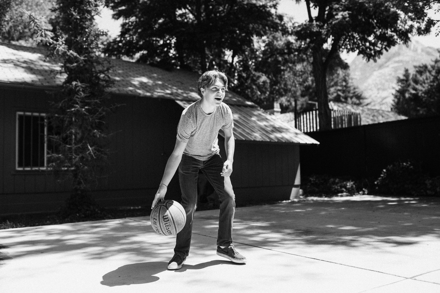 candid-natural-and-artistic-candid-photo-of-boy-playing-basketball-in-backyard-salt lake city-utah