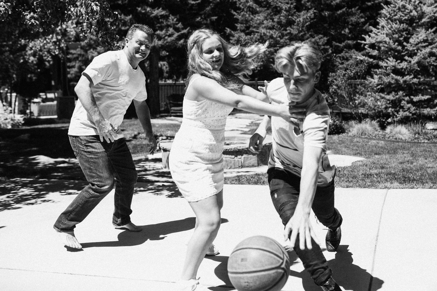 natural-and-artistic-boy-and-girl-playing-ball-during-in-home-family-portrait-session-with-jen-fairchild-photography-saltlakecity-utah