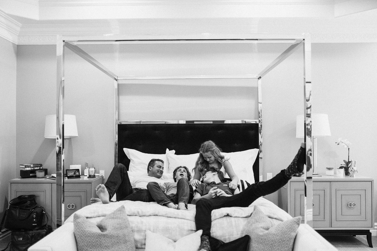 candid-black-and-white-photo-of-family-in-bed-during-in-home-session-with-jen-fairchild-photography-saltlakecity-ut
