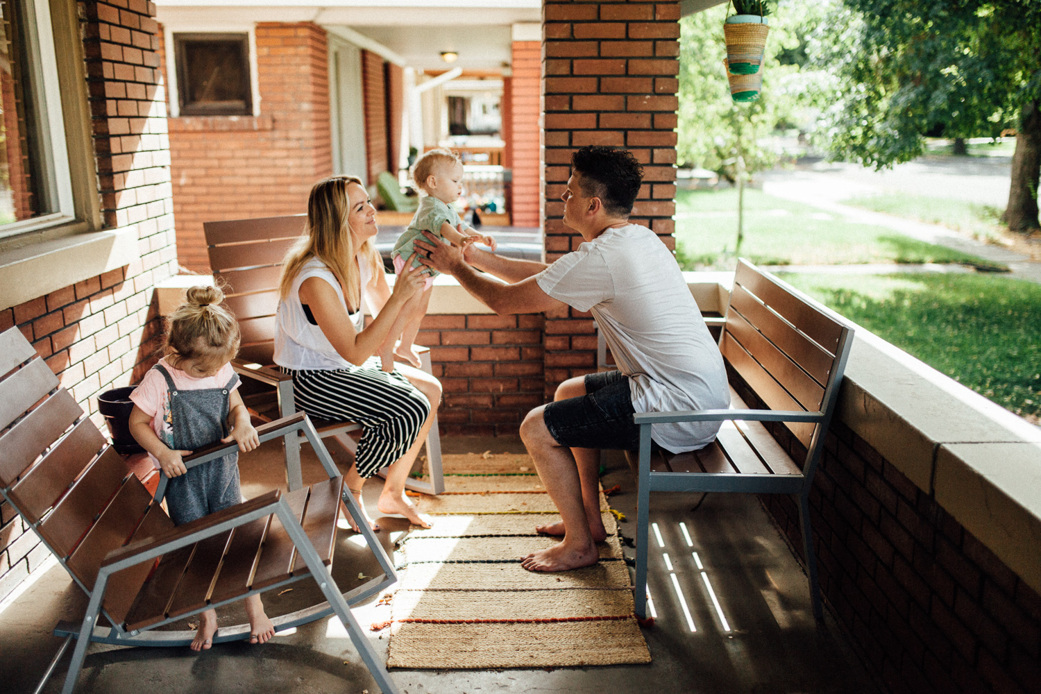 natural-and-artistic-photo-of-family-on-front-porch-during-in-home-session-with-jen-fairchild-photography-slc-ut