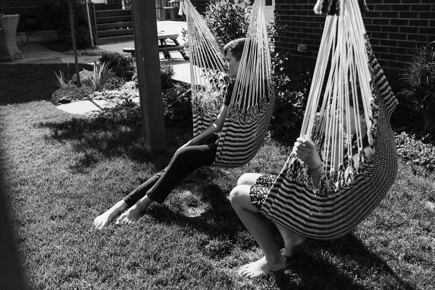 candid-black-and-white-photo-sitting-in-hammock-swings-during-in-home-session-with-jen-fairchild-in-salt-lake-city-utah