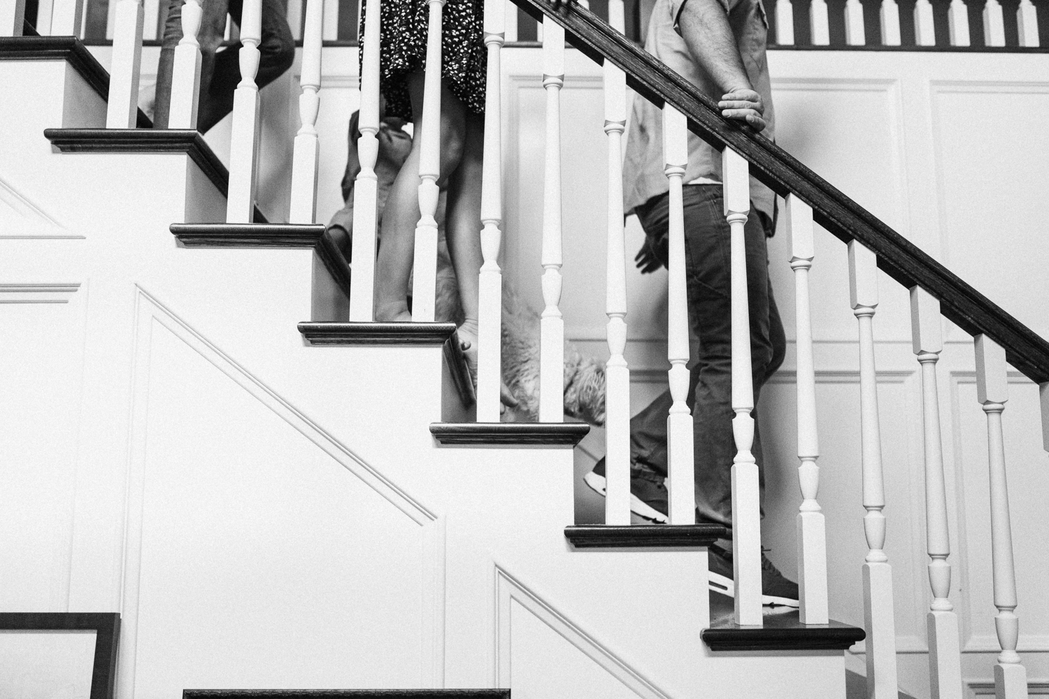 natural-and-artistic-black-and-white-photo-of-family-walking-down-stairs-salt-lake-city-utah