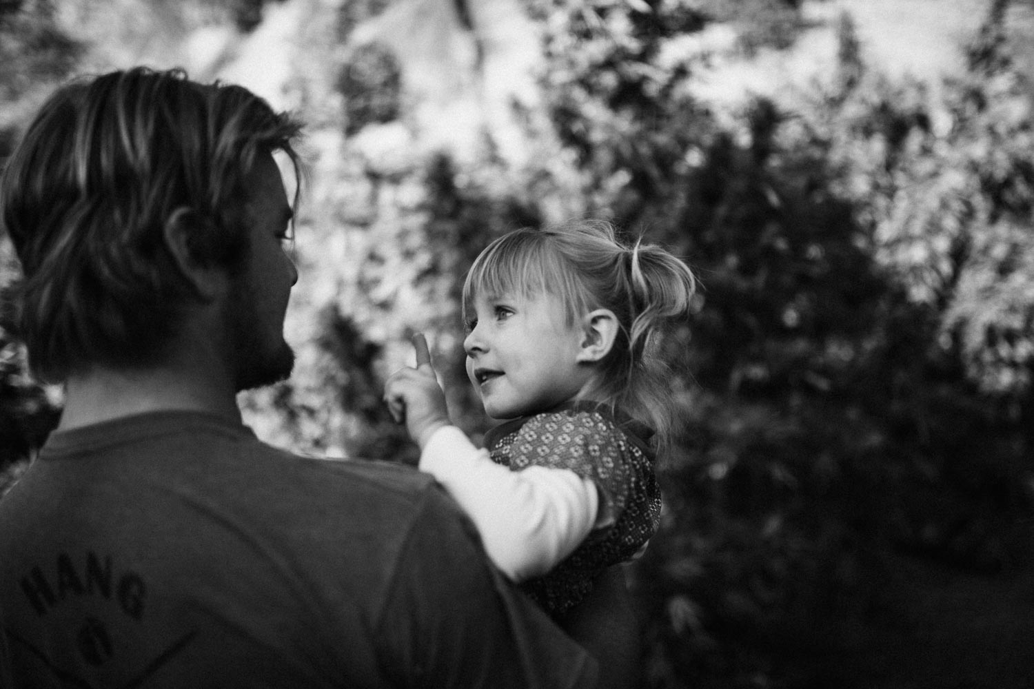 candid-black-and-white-photo-of-boy-holding-and-talking-to-girl-on-weed-farm-during-in-home-session-with-jen-fairchild-photography-benbow-ca