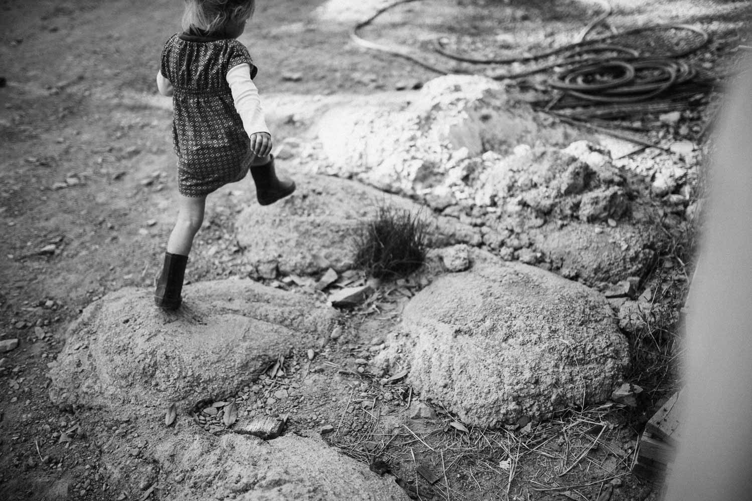 natural-and-artistic-photo-of-little-girl-skipping-along-the-rocks-benbow-ca