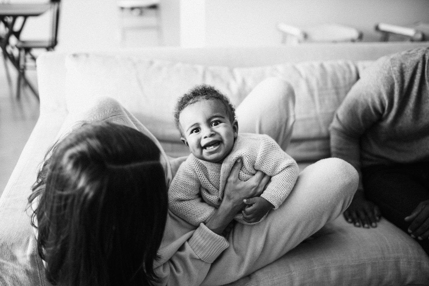 candid-black-and-white-photo-of-mother-and-son-laughing-during-in-home-session-with-jen-farichild-photography-la-california