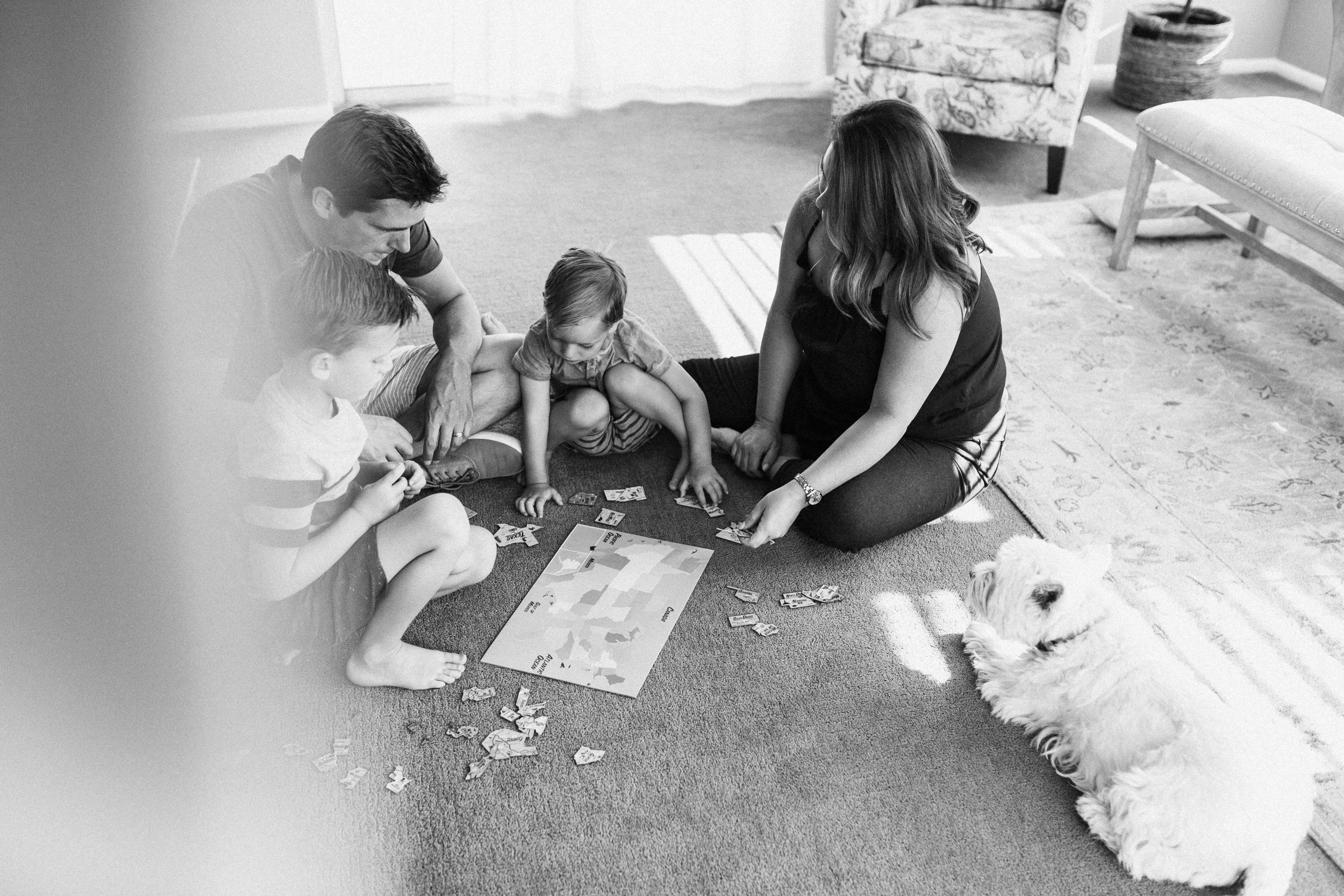 Candid-black-and-white-famly-game-time-photo-during-in-home-session-with-jen-fairchild-photography-slc-utah