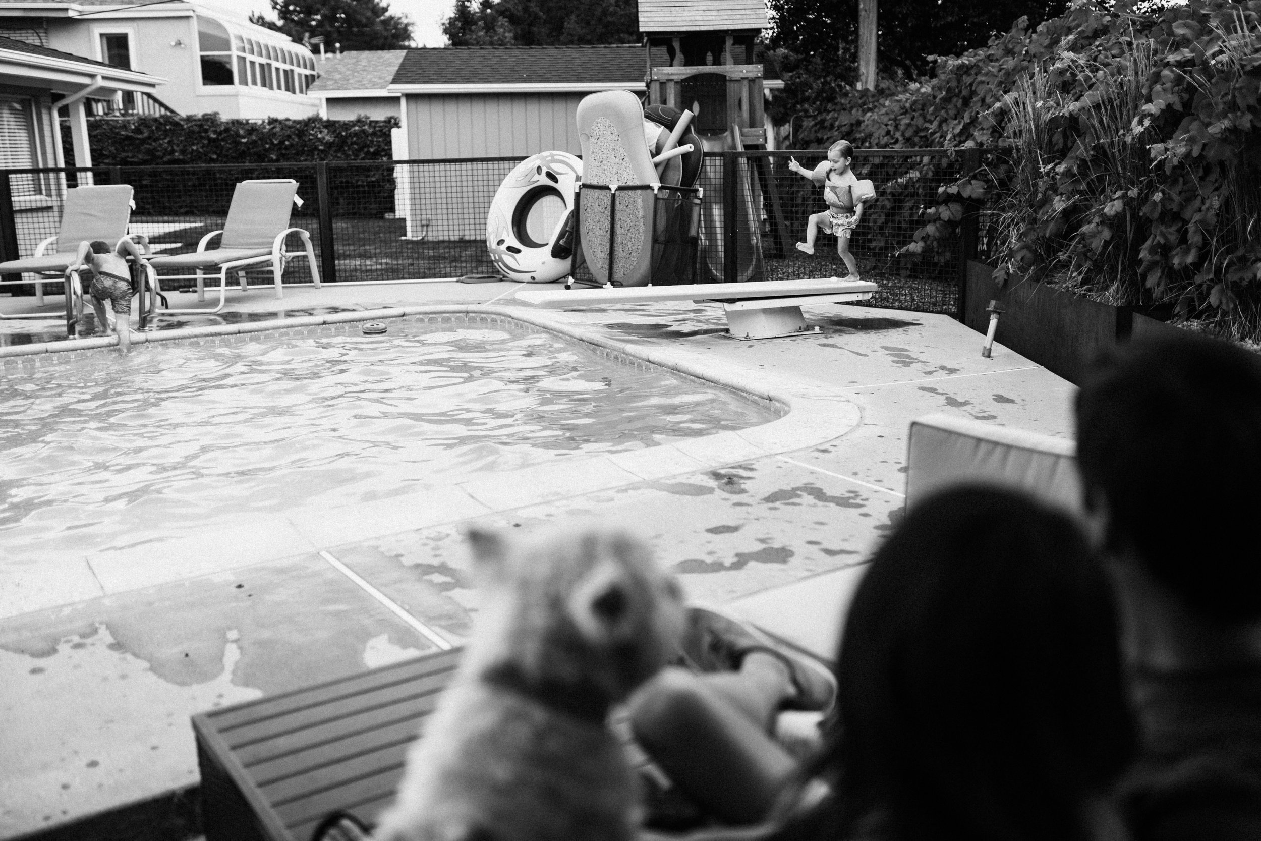 candid-artistic-black-and-white-family-fun-pool-time-during-in-home-session-with-jen-fairchild-photography-slc-utah
