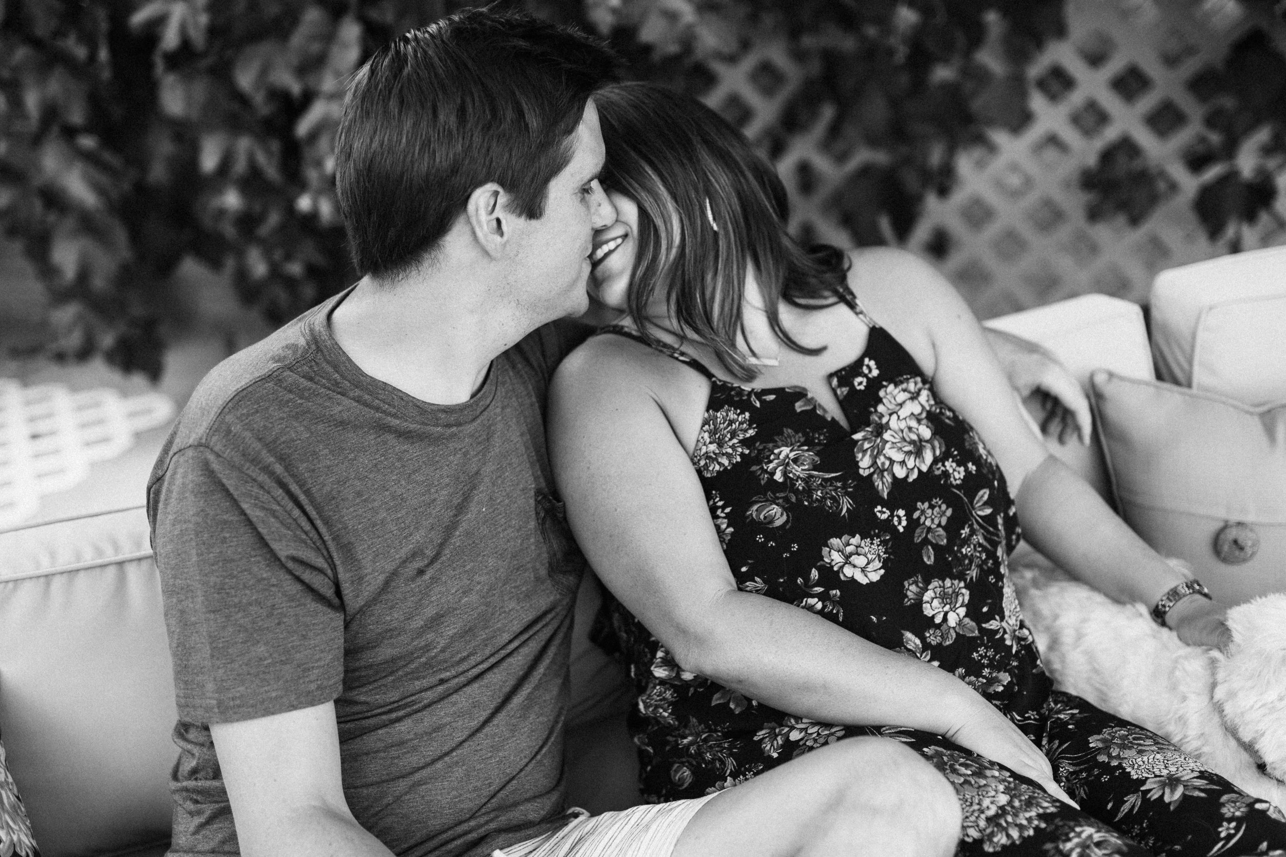 candid-black-and-white-intimate-photo-of-couple-going-in-for-kiss-holladay-utah