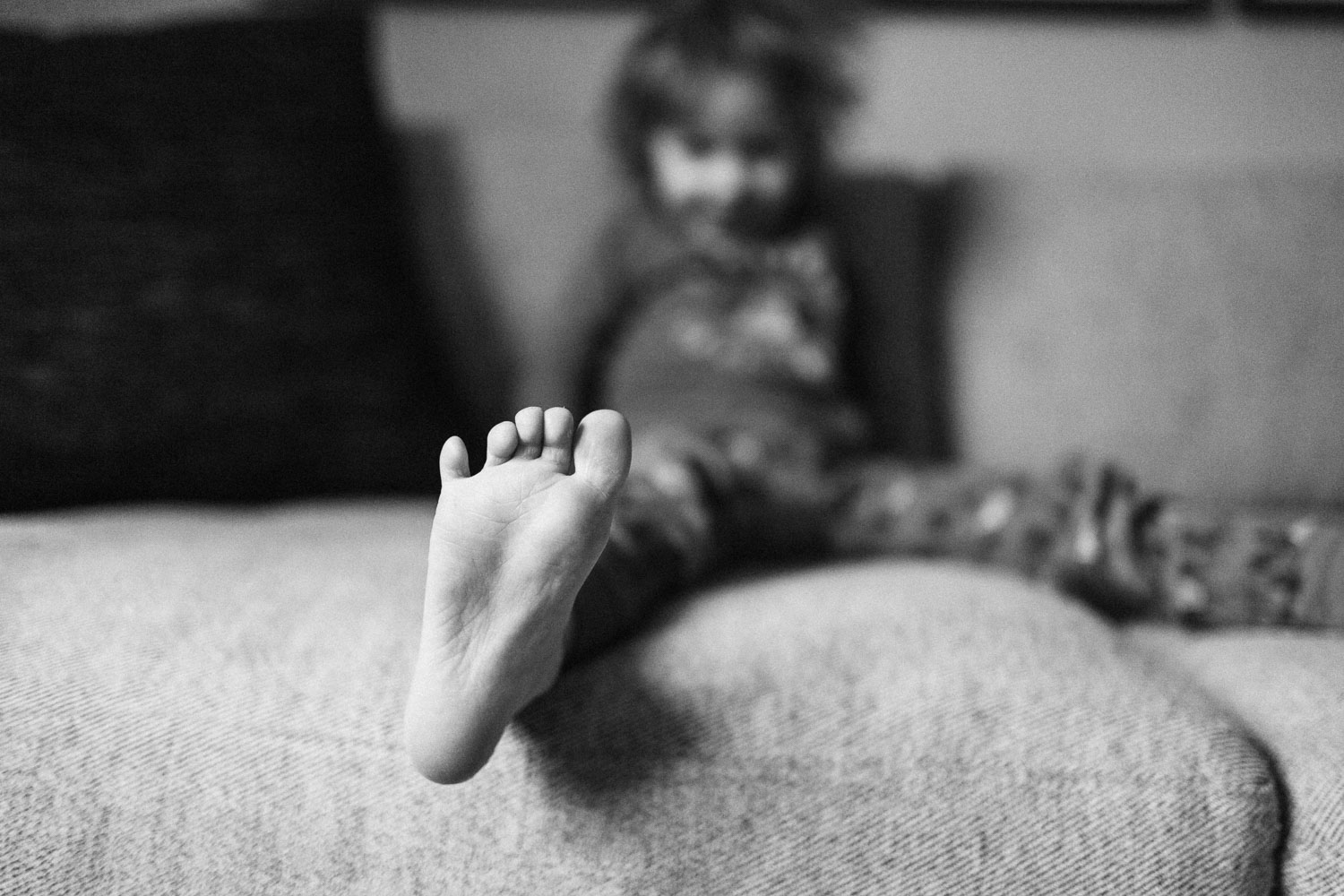 natural-and-artistic-black-and-white-litte-tiny-foot-and-toes-slc-utah