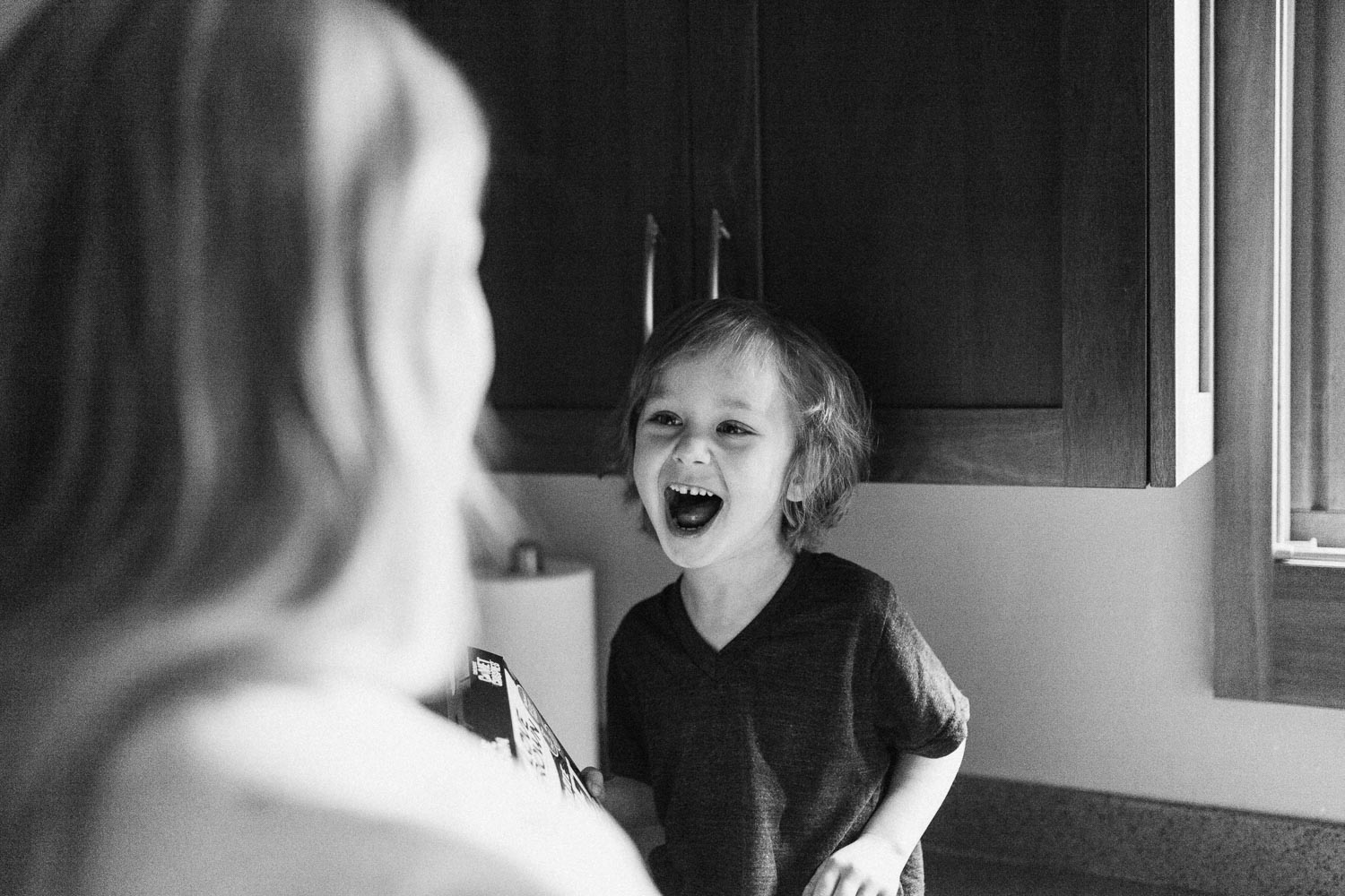 candid-black-and-white-happy-little-boy-cottonwood-heights-utah