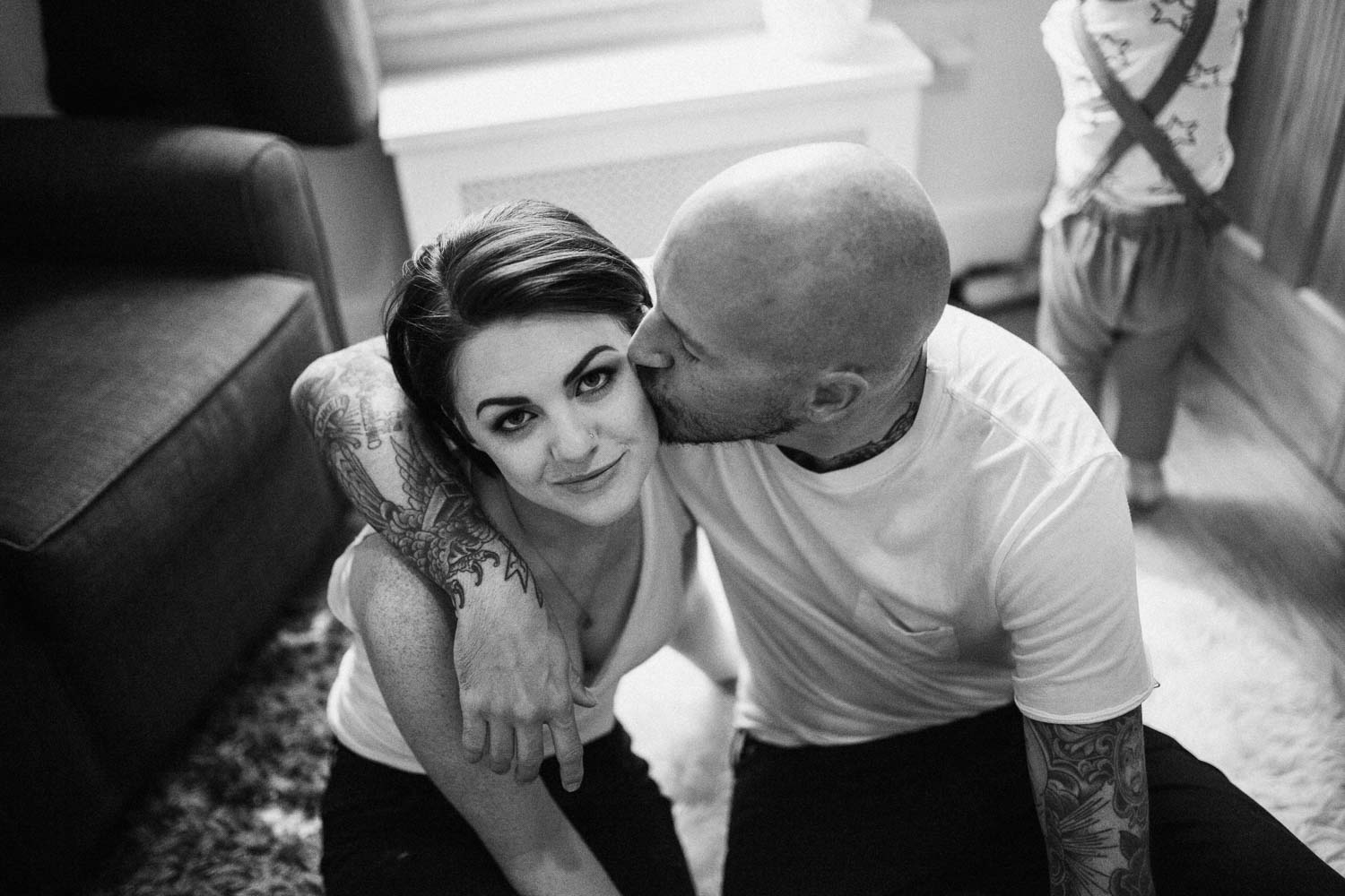 natural-and-bright-black-and-white-loving-intimate-moment-husband-kissing-wife-slc-utah