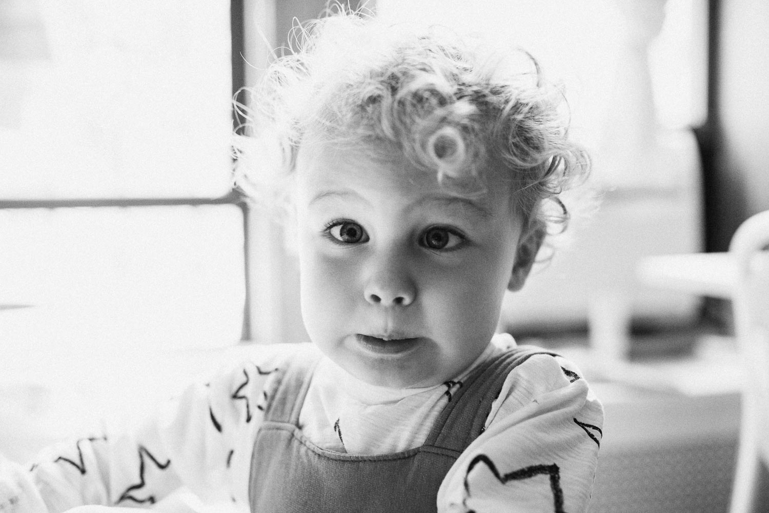 natural-and-artistic-black-and-white-photo-little-boy-making-silly-cross-eyed-face-slc-utah