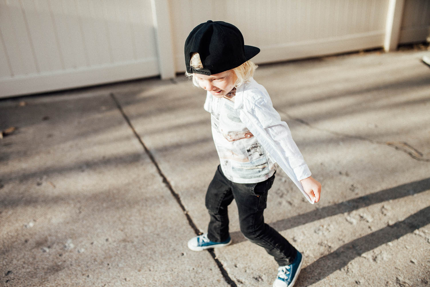 blonde-haired-little-boy-running-around-in-the-notorious-slc-snapback-cottonwood-heights-ut