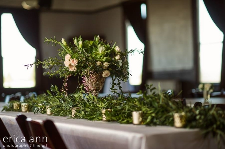 green foliage table runner gold vase votives garden flowers centerpiece table scape sophisticated floral designs