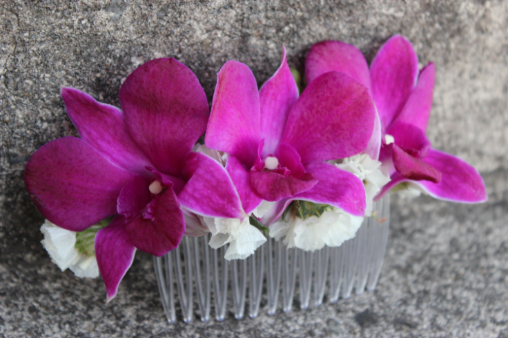 pink purple magents floral comb with fresh orchids flowers