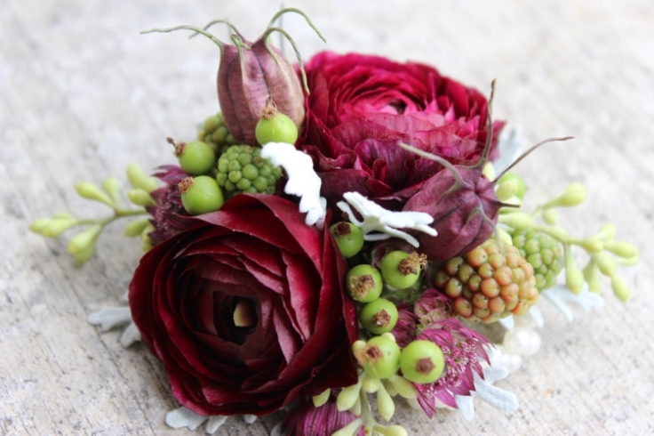 plum purple ranunculus wrist corsage wedding flowers
