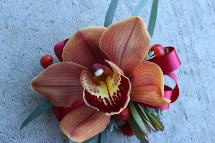 wrist corsage orange orchid boutonniere