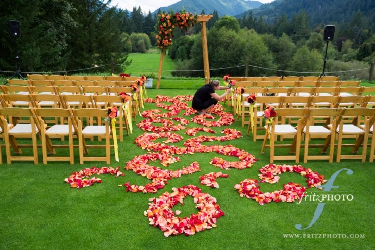 floral aisle rose petals swirl sophisticated floral resort at the mountain wedding